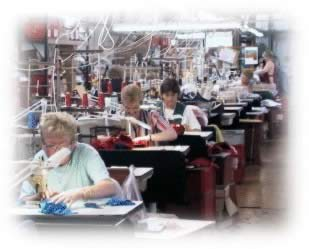 Image of women working in garment trade production line -